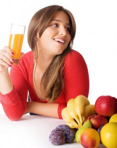 Pretty-young-woman-holding-a-glass-of-fruit-juice-810x1024